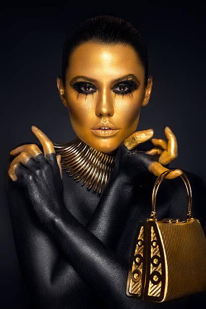beautiful woman portrait in gold and black colors - schwarzer puma stock-fotos und bilder