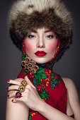 istock Beautiful woman portrait in russian style 577646124