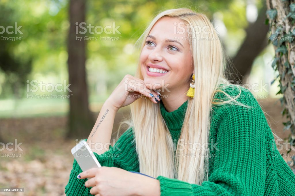 Beautiful Woman Portrait in the Autumn Park royalty-free stock photo