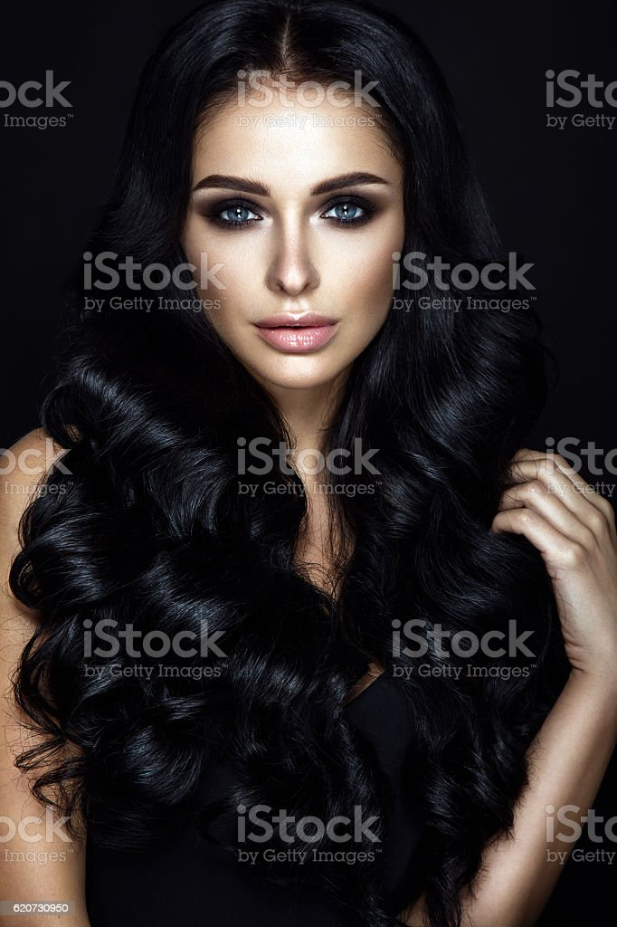 Beautiful woman portrait on black background. stock photo