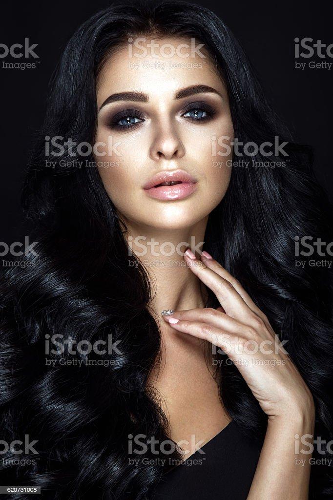 Beautiful woman portrait on black background. stock photo