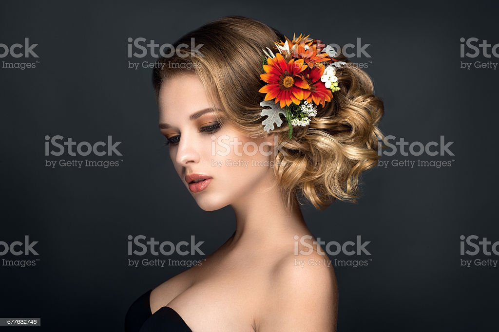 Beautiful woman portrait with flowers in hair. Autumn bride stock photo
