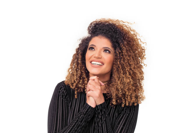 Beautiful woman portrait with gorgeous curly hair praying for something stock photo