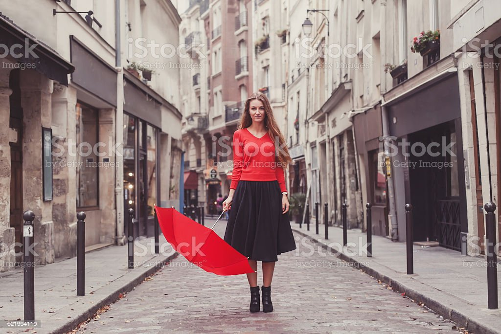 beautiful woman, portrait with red umbrella on the street ストックフォト