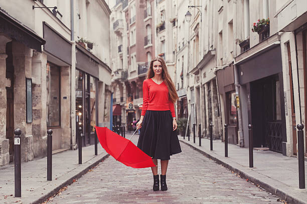 beautiful woman, portrait with red umbrella on the street stock photo