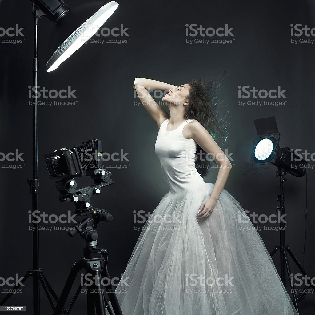 Beautiful woman pose in photo-studio royalty-free stock photo