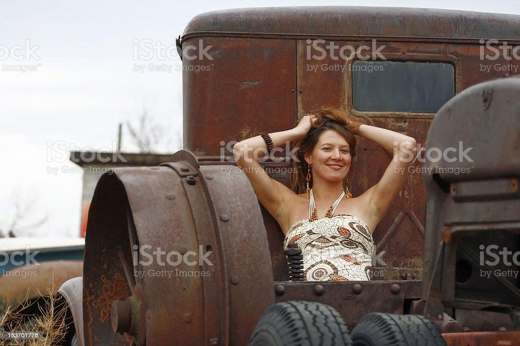 Beautiful Woman Posing in a Salvage Yard royalty-free stock photo