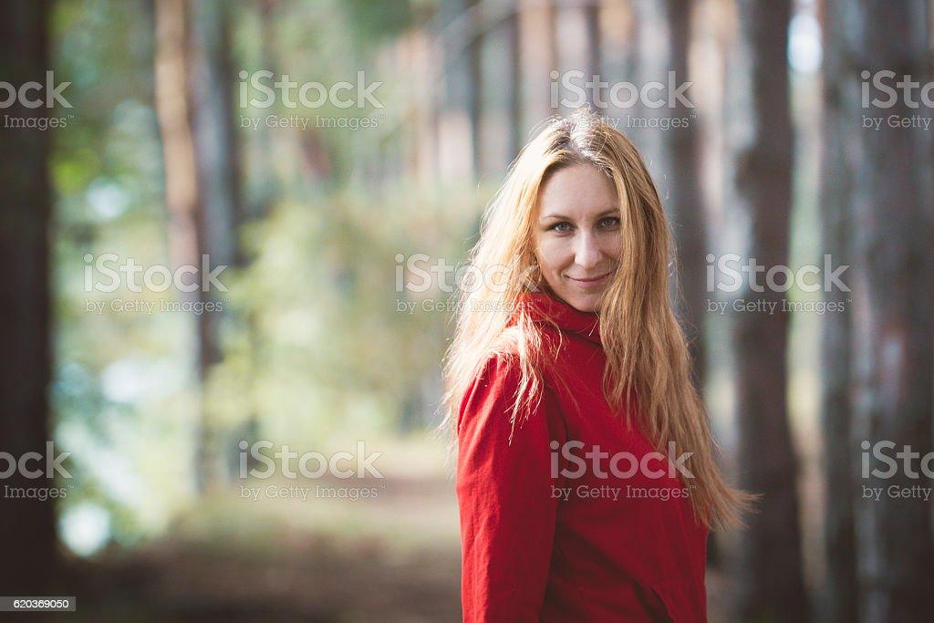 Beautiful woman posing in autumn park, blonde hair, red sweatshirt zbiór zdjęć royalty-free
