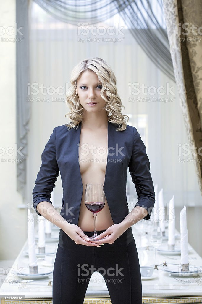 Beautiful woman posing with glass of red wine royalty-free stock photo