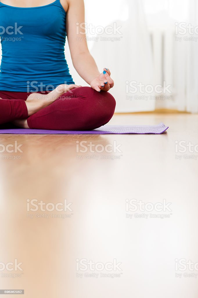 Beautiful woman practicing yoga and sitting in lotus asana royalty-free stock photo
