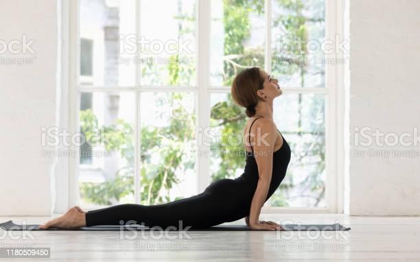 Beautiful woman practicing yoga cobra pose bhujangasana exercise picture id1180509450?b=1&k=6&m=1180509450&s=612x612&h=awtzhr9lodznvul4er89nrq g27jn  av6py3n7wsbe=