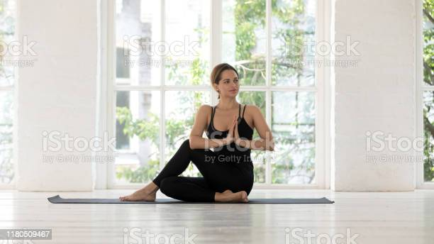 Beautiful woman practicing yoga doing ardha matsyendrasana exercise picture id1180509467?b=1&k=6&m=1180509467&s=612x612&h=cz qph 8nd kbkfq bryjtpft  cjhjupvdcaumk25c=
