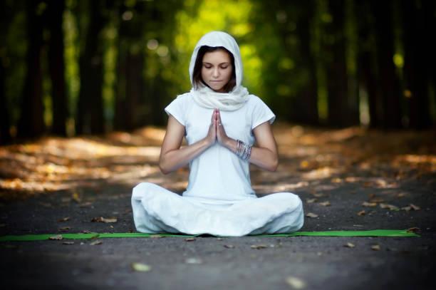 Beautiful woman practicing yoga stock photo