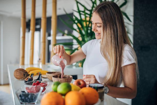Beautiful woman preparing healthy breakfast stock photo