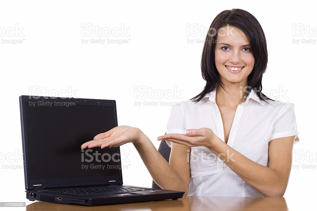 Beautiful Woman presenting Laptop computer royalty-free stock photo