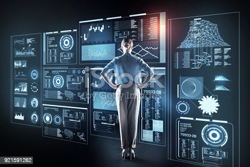 istock Beautiful woman putting her hands on the hips while being at work 921591262