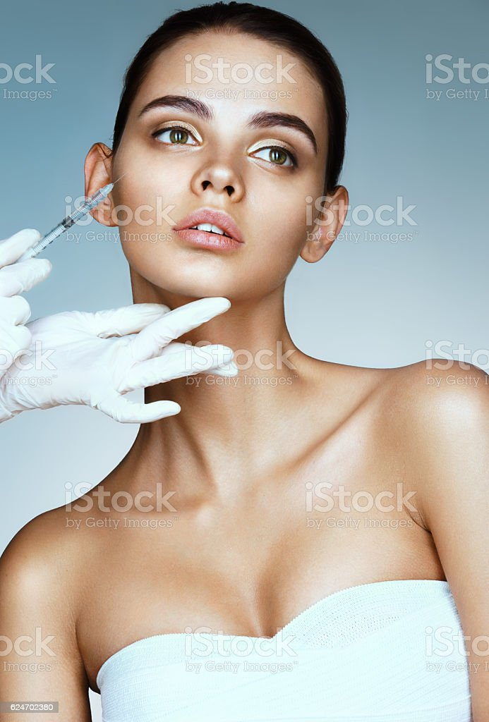 Beautiful woman receiving botox injection stock photo