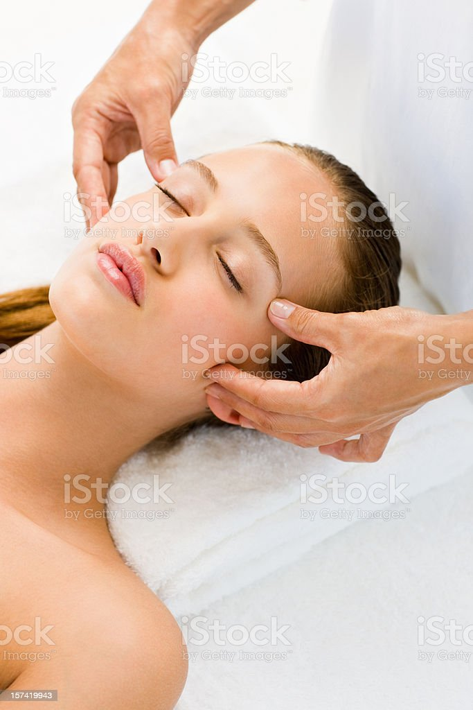 Beautiful woman receiving face massage royalty-free stock photo