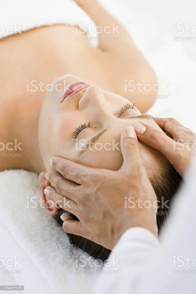 Beautiful woman receiving head massage at spa royalty-free stock photo