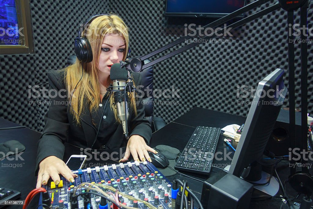 Beautiful Woman Recording Sound In Media Studio stock photo
