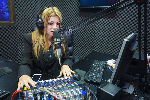 beautiful woman recording sound in media studio - radio dj stock photos and pictures