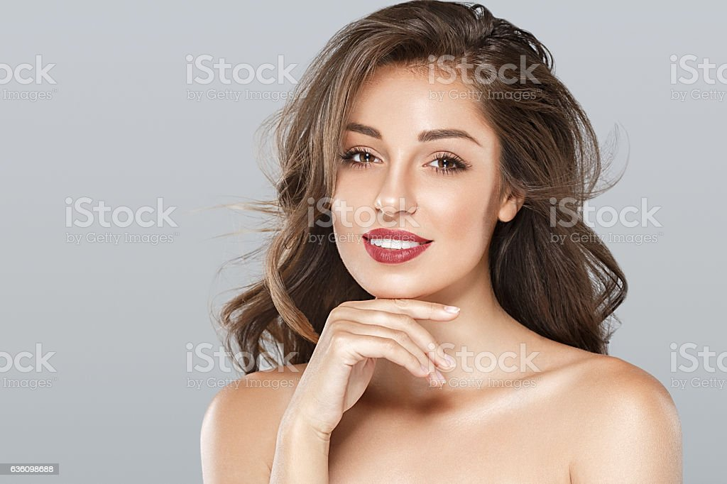 Beautiful woman red lips fly hair portrait - foto stock