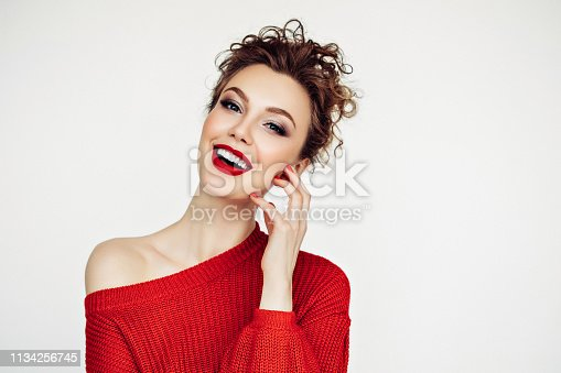 Beautiful woman. Red sweater and red lipstick.