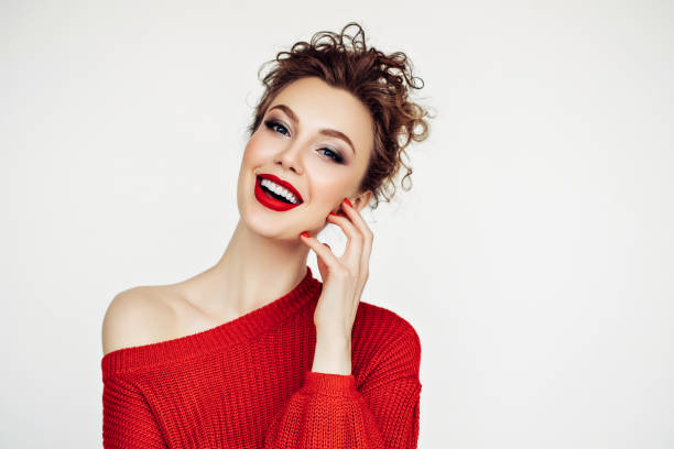 Beautiful woman. Red sweater and red lipstick. Beautiful woman. Red sweater and red lipstick. red shirt stock pictures, royalty-free photos & images