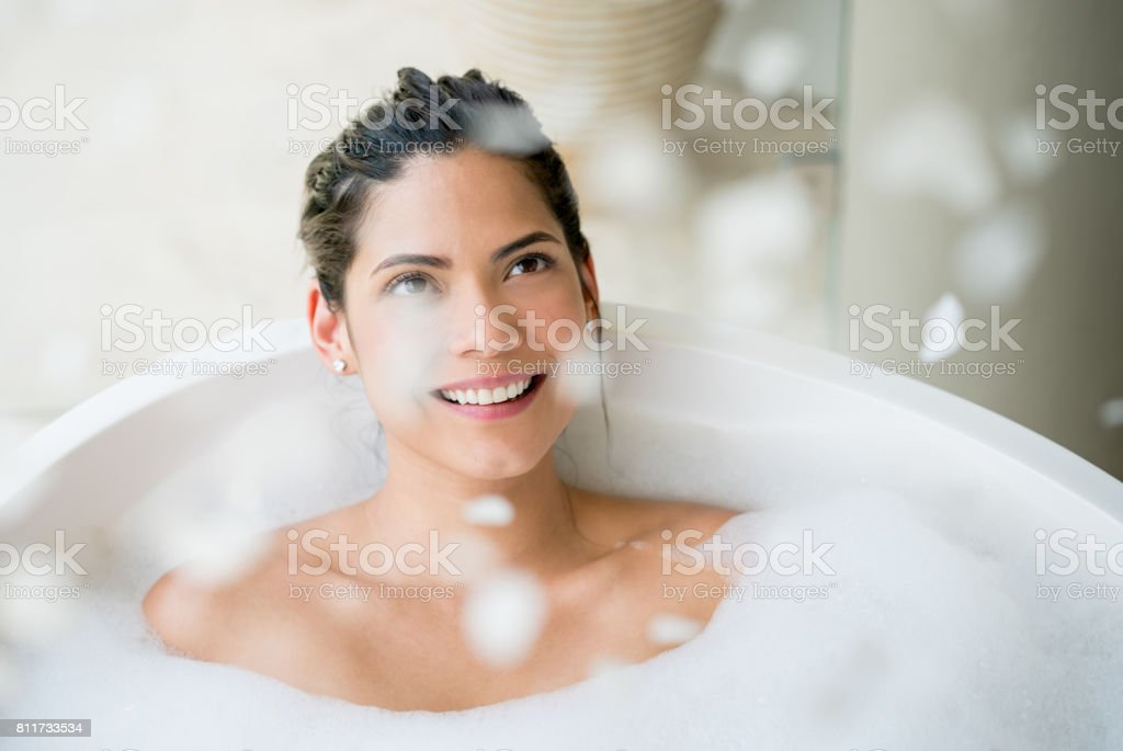 Beautiful woman relaxing and taking a bath stock photo