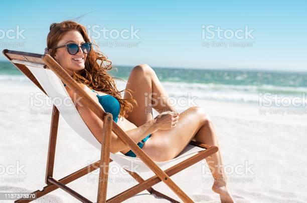 Beautiful woman relaxing at beach picture id1137373370?b=1&k=6&m=1137373370&s=612x612&h=vaepmfmaxu1rjdfpeviqs0xwsrjl9oh9q3ucndfrda4=