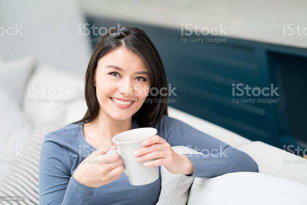 Beautiful woman relaxing at home royaltyfri bildbanksbilder