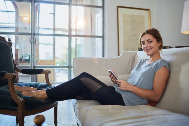 Beautiful woman relaxing at home. stock photo