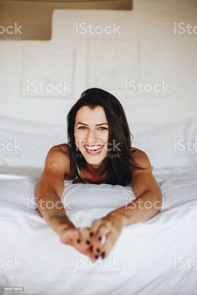 Beautiful woman relaxing in bed - Royalty-free Adult Stock Photo