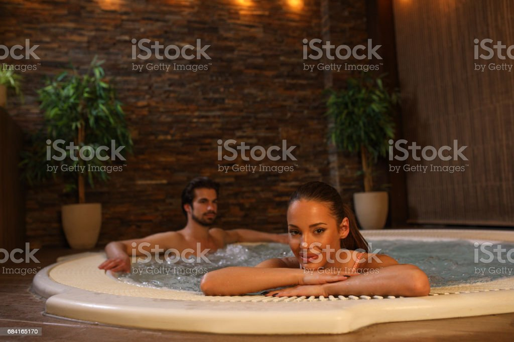 Beautiful woman relaxing in hot tub at health spa. royalty-free stock photo