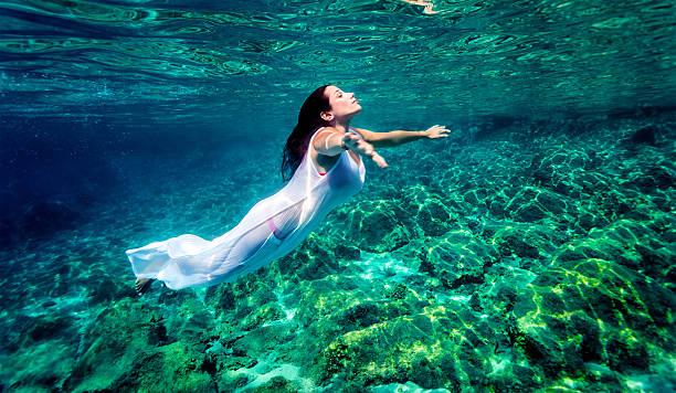 Beautiful woman relaxing in the water stock photo