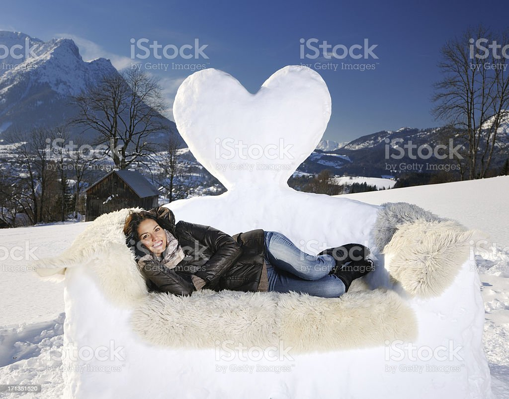 Beautiful woman relaxing on a Snow Sofa, Winter Panorama (XXXL) royalty-free stock photo