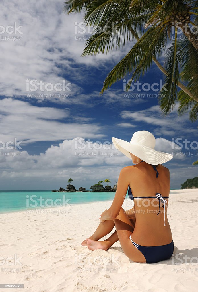 Beautiful Woman relaxing on a White Sand Beach royalty-free stock photo