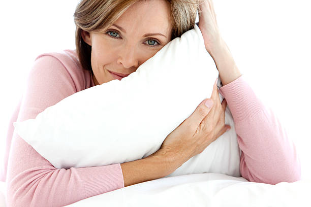 Beautiful Woman relaxing on bed stock photo