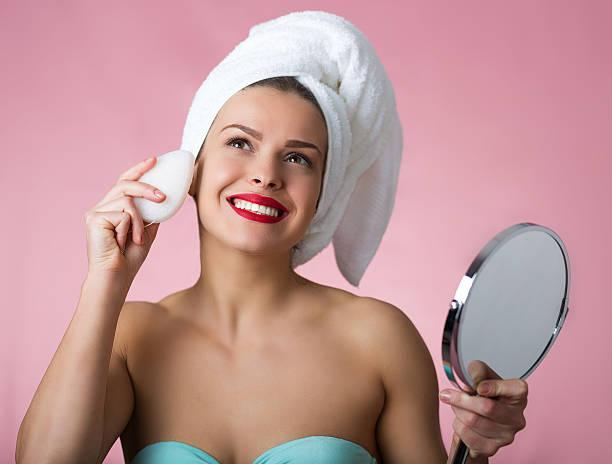 Beautiful woman removing makeup stock photo