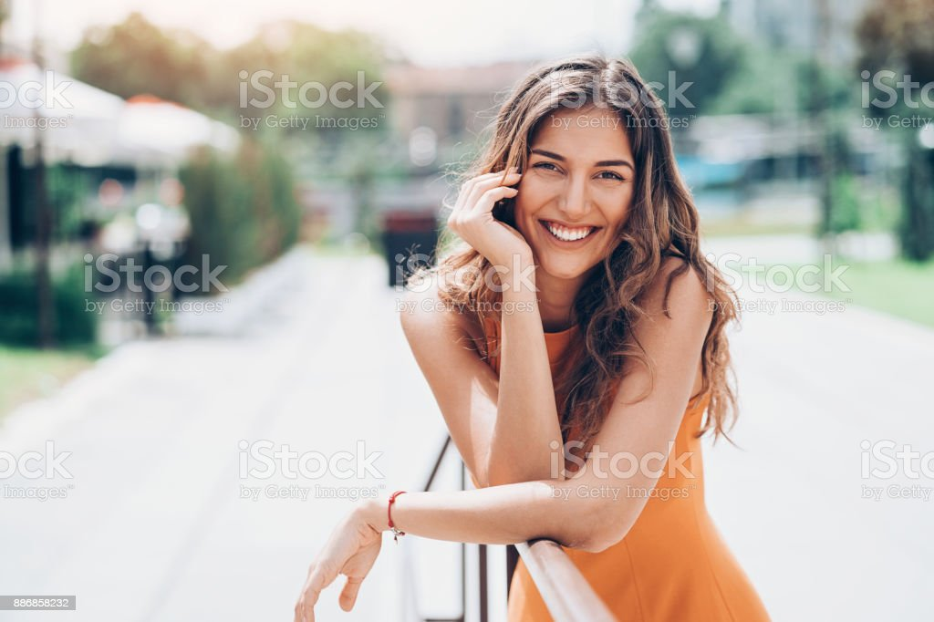 Beautiful woman resting outdoors at sunlight stock photo