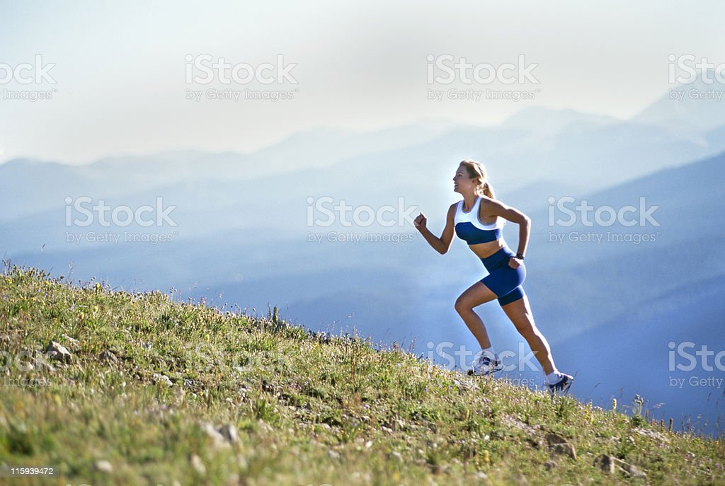 Beautiful Woman Running up Mountain stock photo