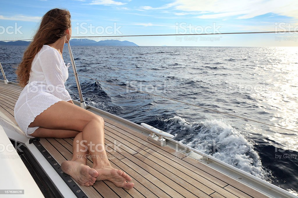 Beautiful woman sailing royalty-free stock photo