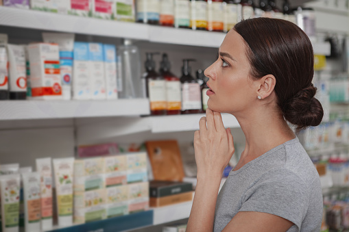 istock Beautiful woman shopping at pharmacy 1160188560