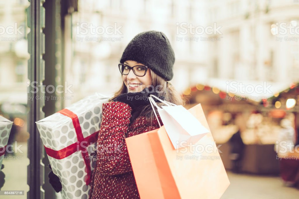 Beautiful woman shopping in the city stock photo