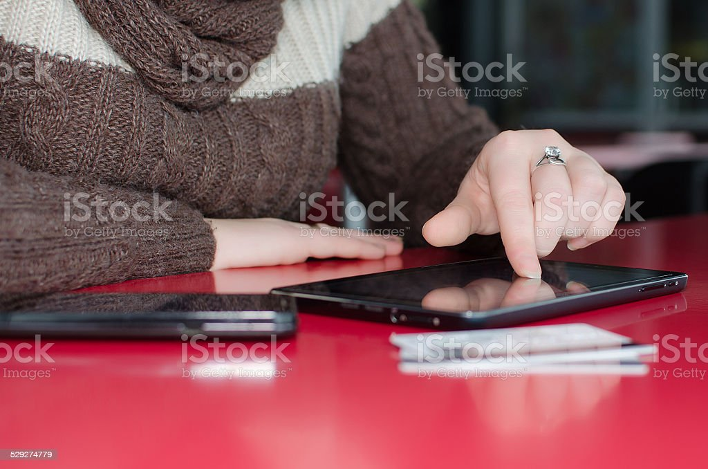 Beautiful woman shopping online on a Tablet PC stock photo