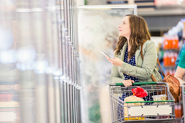 Beautiful woman shopping with mobile stock photo
