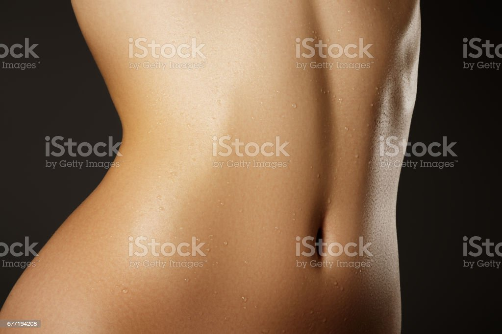 Beautiful woman show her tan slim body. Beautiful slim woman bod stock photo