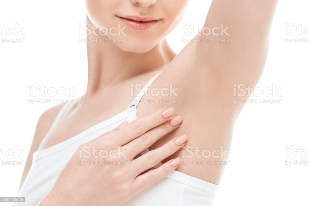 beautiful woman showing armpits isolated on white. skin care woman concept stock photo