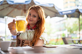 Beautiful Woman Showing Beer at Pub
