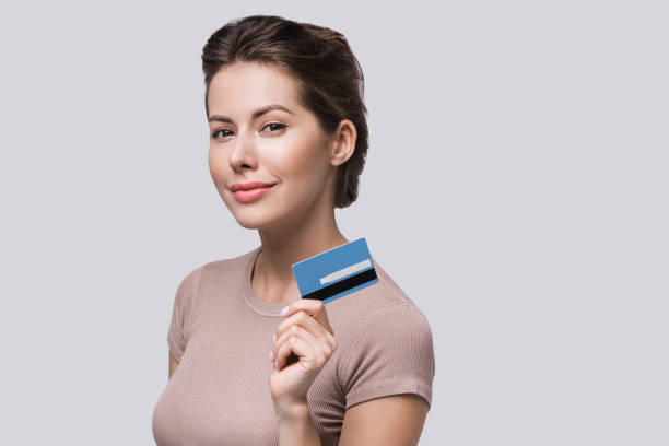 Beautiful woman showing credit card stock photo